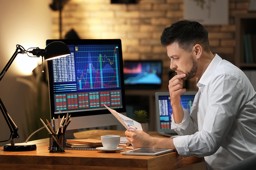 Investor analyzing charts